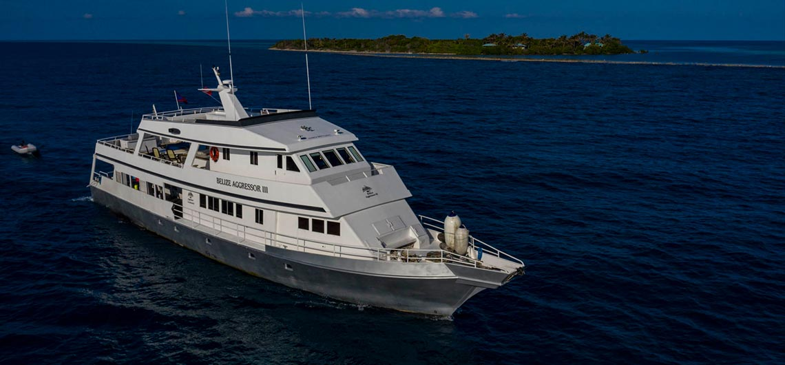 Belize Aggressor III floating in front of island