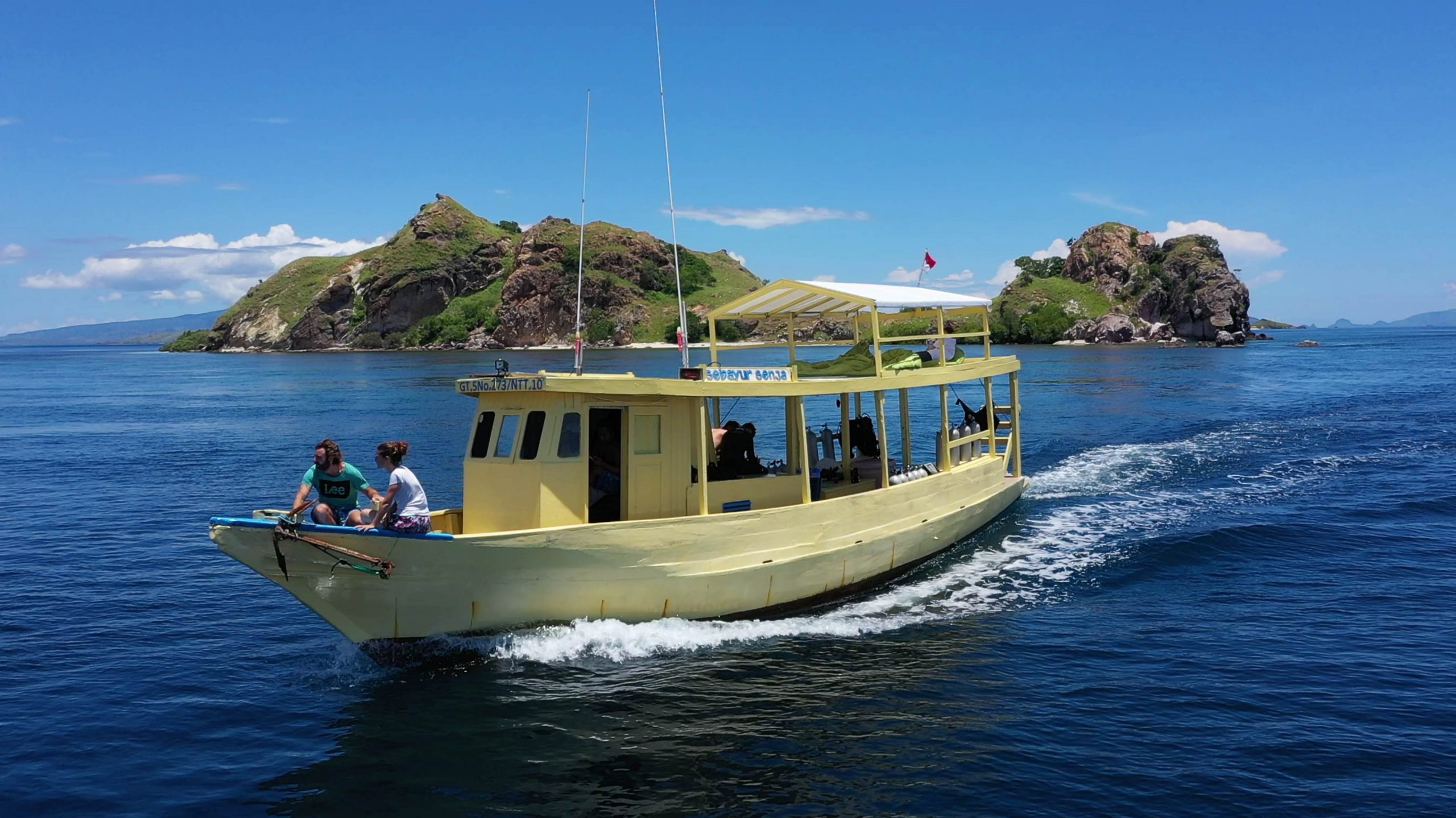 Komodo Resort Dive boat with guests on the bow