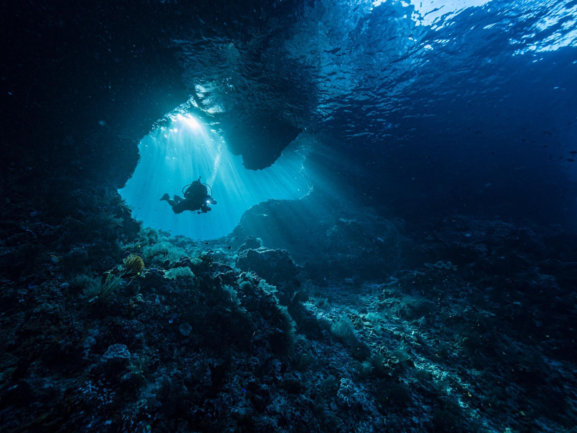 diver in underwater tunnel