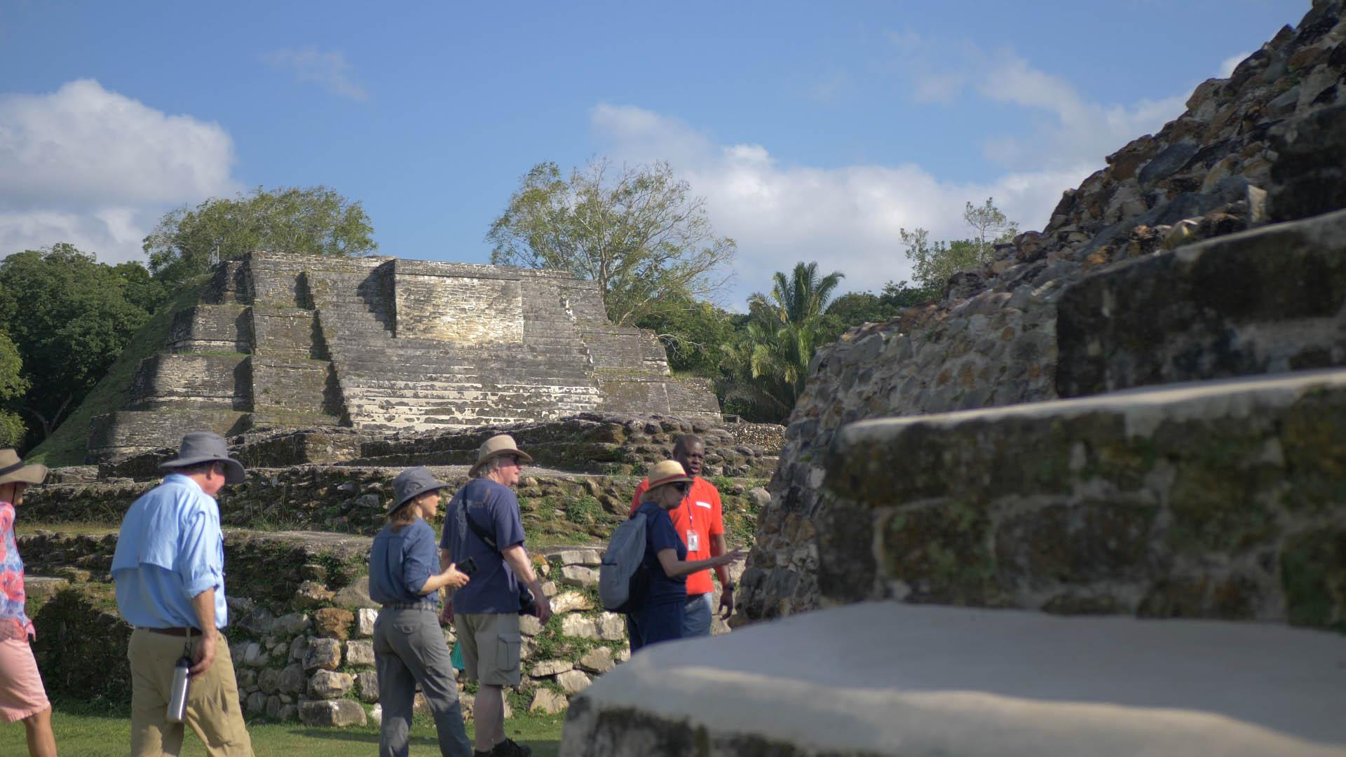 Guests walk through Mayan Ruins in Belize