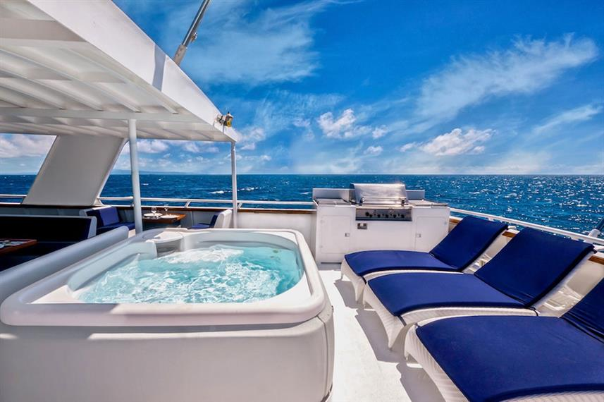 Jacuzzi and sun loungers on top deck of Atlantis Azores Liveaboard
